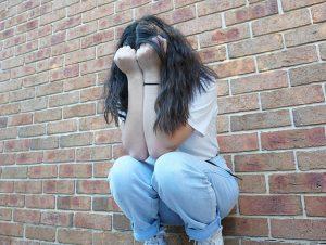 Depressed girl crying