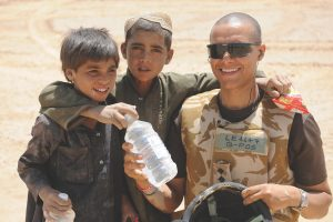 Clive Lewis in Afghanistan with local children